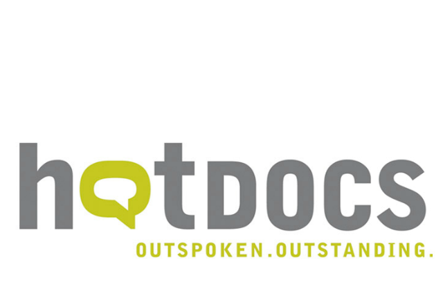 """Hot Docs logo: lower case in grey letters with additional text, """" Outspoken. Outstanding."""" First """"o"""" of Hot Docs has a white speech bubble inside a green speech bubble"""