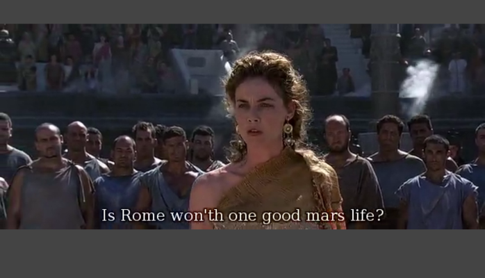 "A noble ancient Roman woman stands inside a large arena, with a group of lower-classed men listening to her, and stadium step seating full of spectators. Caption reads: ""Is Rome won'th one good mars life?"""