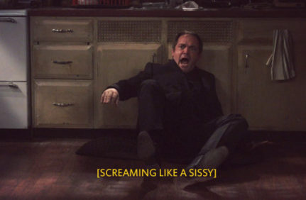 "A middle-aged man is on the floor against filthy kitchen cupboards, screaming and recoiling from something in front of him off screen. Caption reads: ""[SCREAMING LIKE A SISSY]"""