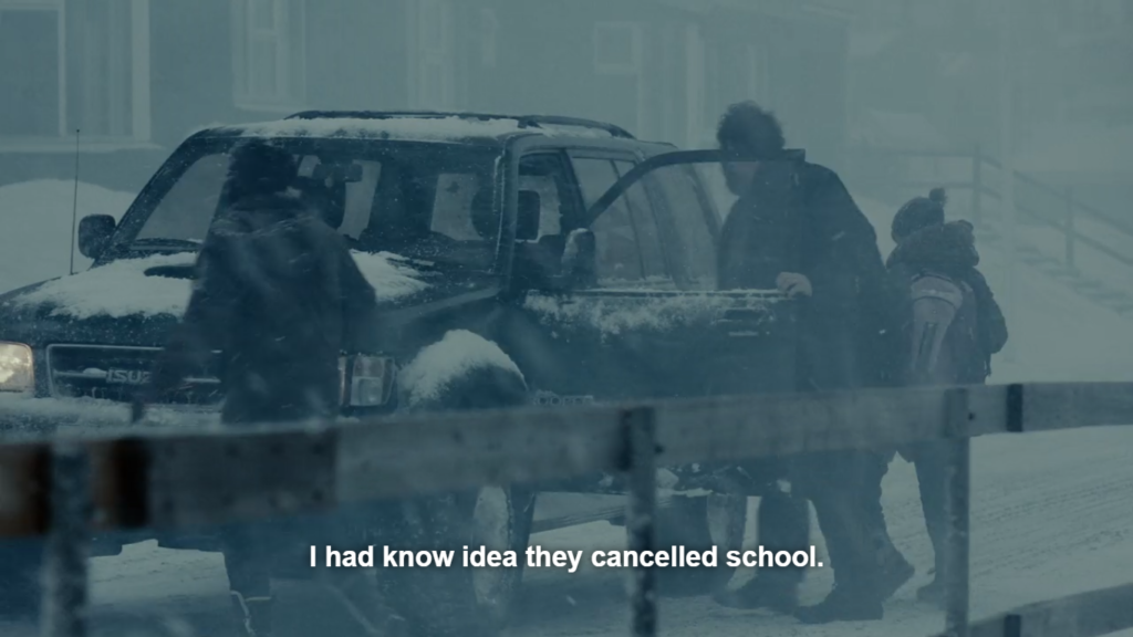 """Street scene with dark, snowy day; a man, woman and two children are getting into an Isuzu SUV by different doors. Caption reads: """"I had know idea they cancelled school."""""""