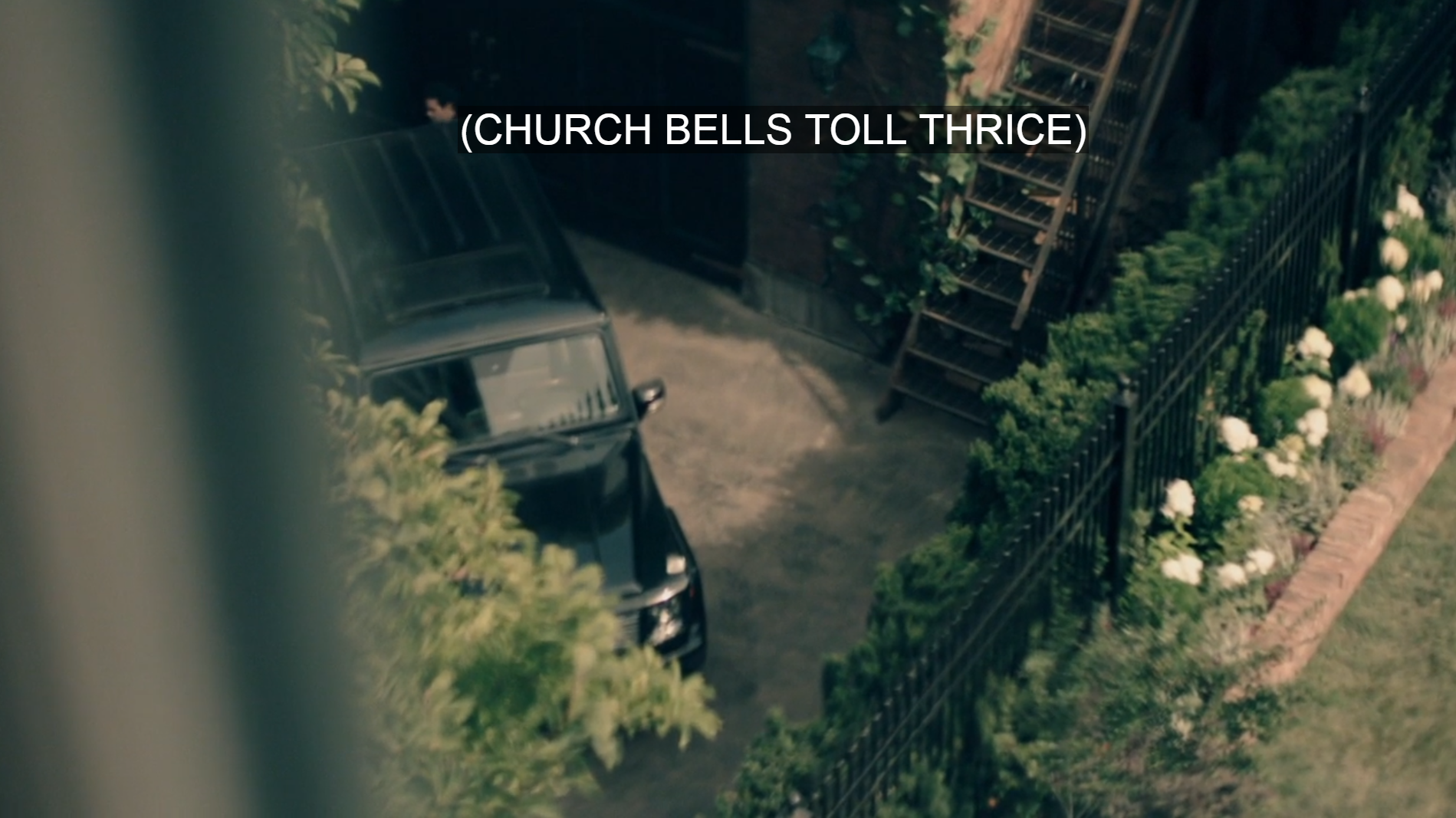 Looking down from window to SUV in a driveway by a garden. Caption: (CHURCH BELLS TOLL THRICE)