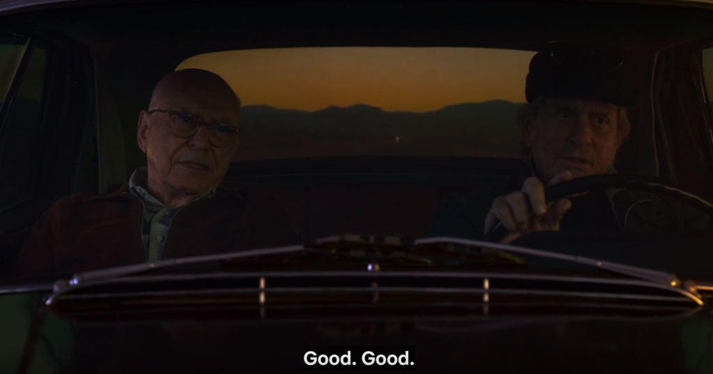 "Alan Arkin and Michael Douglas seen through a car window while the latter is driving, captioned, ""Good. Good."""