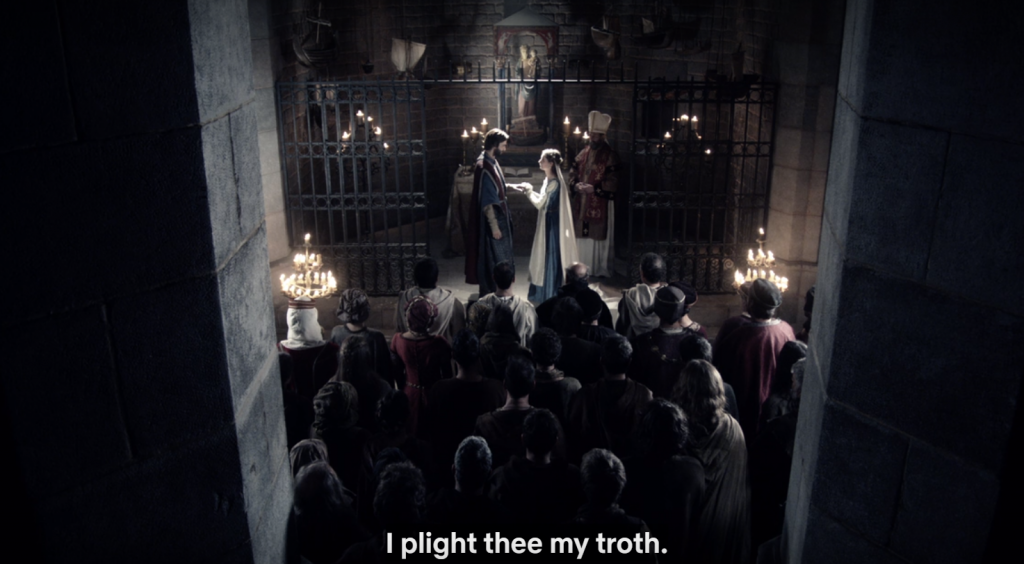 "Longshot of medieval wedding scene in a chapel, captioned ""I plight thee my troth."""