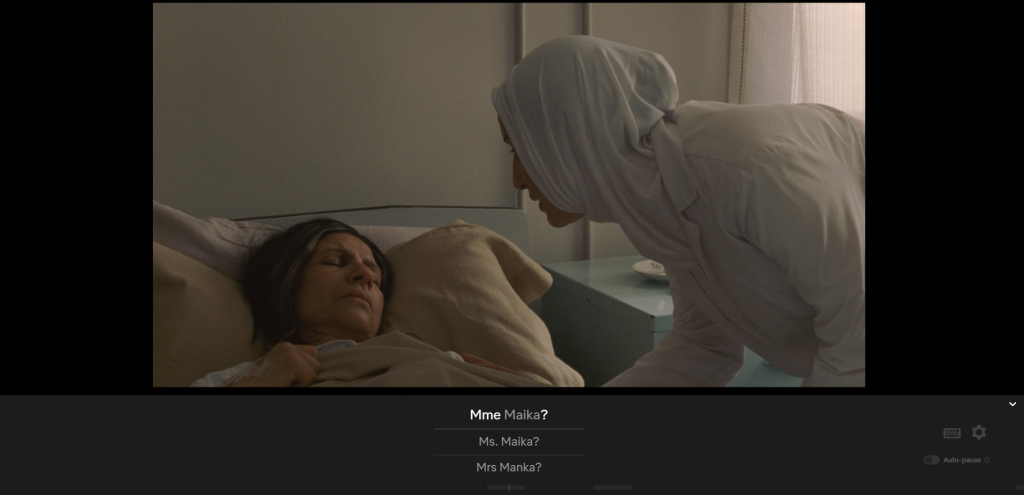 Middleeastern-dressed nurse speaking over an ill Middleeastern woman's bed, captioned Mme Mika?/Ms. Maika?/Mrs Manka?